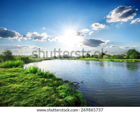 Sun over calm river in the spring morning #269865737