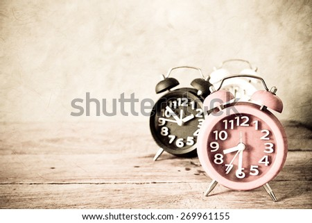 alarm clock on wood table in vintage color style            #269961155
