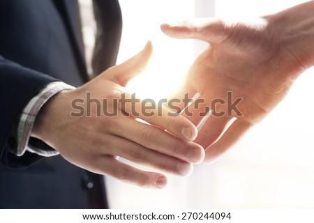 Handshake  Royalty-Free Stock Photo #270244094