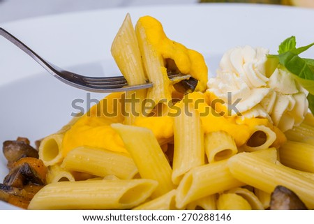 Penne pasta with pumpkin, tofu and mushrooms #270288146