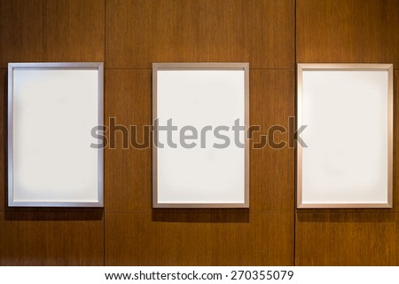 3 Blank white paper canvas photo  frame on the wood wall for a bulletin #270355079