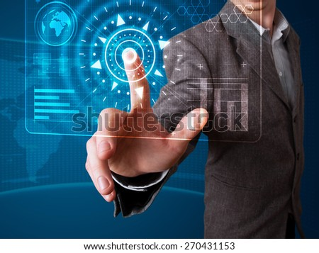 Young businessman pressing high tech type of modern buttons #270431153