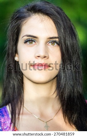 Beautiful girl posing in the park. Image has grain texture visible on maximum size #270481859