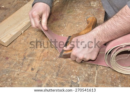 carpenter working with plane on wooden #270541613
