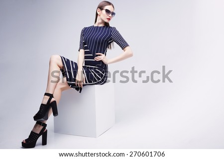 high fashion portrait of young elegant woman. Studio shot  #270601706