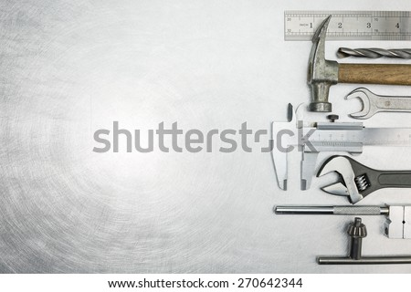 Set of  metal working tools on scratched background Royalty-Free Stock Photo #270642344