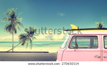 Vintage car in the beach with a surfboard on the roof Royalty-Free Stock Photo #270650114