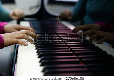 Teenager playing a piano, close-up on hands and keyboard. Rehearsal, school and discipline concept.  #270686105