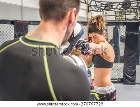 mma fighting training in the cage. concept about sport, fitness,mma,kickboxing,training, and people Royalty-Free Stock Photo #270767729