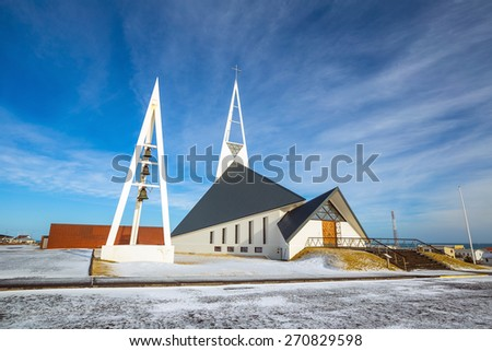 ICELAND - MARCH 15, 2015 : Olafsvik Church at foot of massive, steep Enni mountain in Iceland on MArch 15, 2015 #270829598