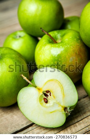 green apples on wooden background #270836573