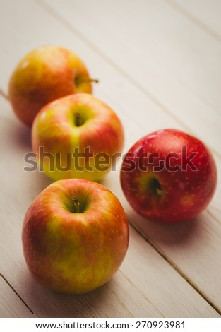 Fresh red apples on wooden background #270923981