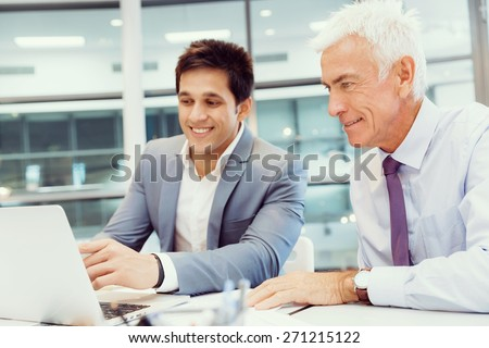 Two businessmen in fornt of computer in office #271215122