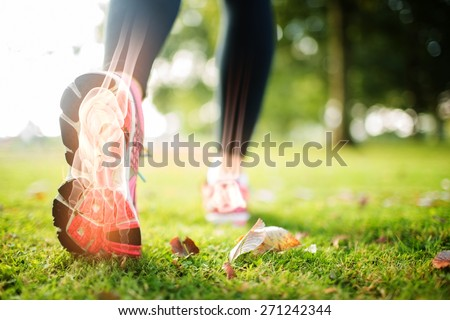 Digital composite of Highlighted foot bones of jogging woman Royalty-Free Stock Photo #271242344
