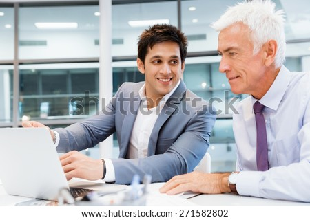 Two businessmen in fornt of computer in office #271582802