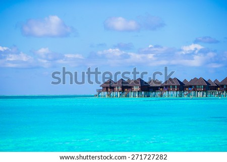 Water villas, bungalows on ideal perfect tropical island #271727282