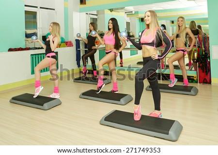 Fitness center. Image of athletic girls training  #271749353
