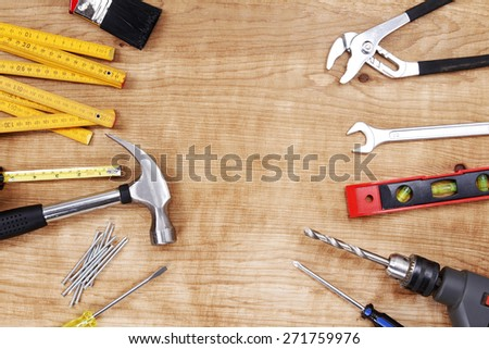 Assorted work tools on wood. Copy space #271759976