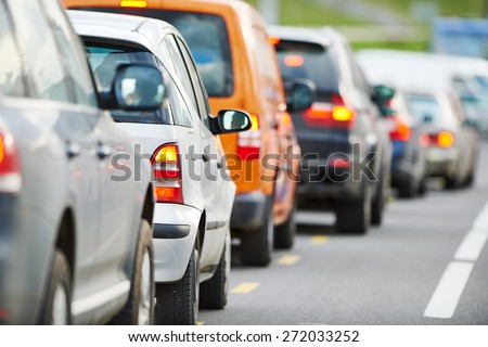traffic jam in a city street road during rush hour  #272033252