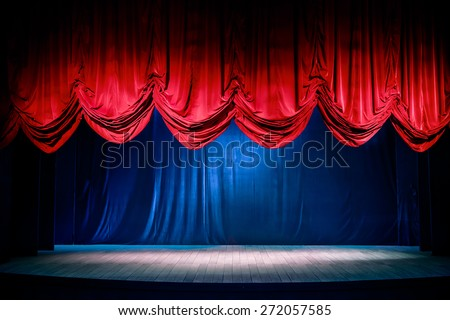 Theater curtain and stage with dramatic lighting Royalty-Free Stock Photo #272057585