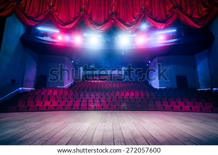 Theater curtain and stage with dramatic lighting Royalty-Free Stock Photo #272057600