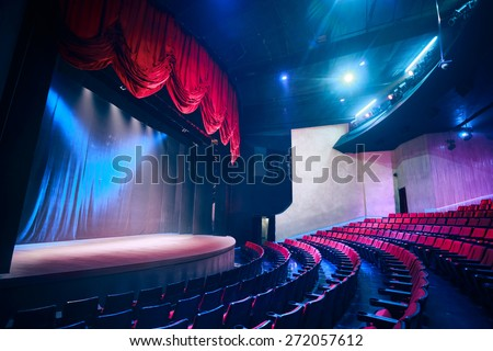 Theater curtain and stage with dramatic lighting Royalty-Free Stock Photo #272057612