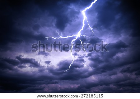 Lightning strike on the dark cloudy sky