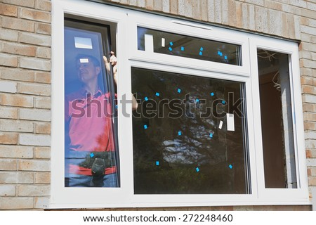 Construction Worker Installing New Windows In House #272248460