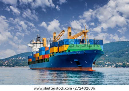 merchant container ship Royalty-Free Stock Photo #272482886