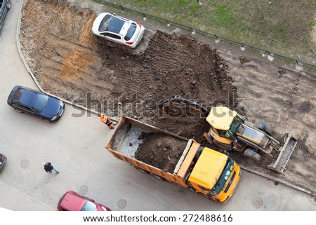 ST. PETERSBURG, RUSSIA - CIRCA APR, 2015: Wrong parking car is on lawn while construction machinery works for extension of parking area of apartment building. Creation of living environment in city #272488616