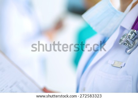 Woman doctor standing with folder at hospital  #272583323