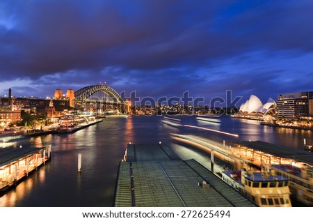 Australia Sydney major city landmark - circular quay at sunset view towards Harbour Bridge and passenger ferries Royalty-Free Stock Photo #272625494