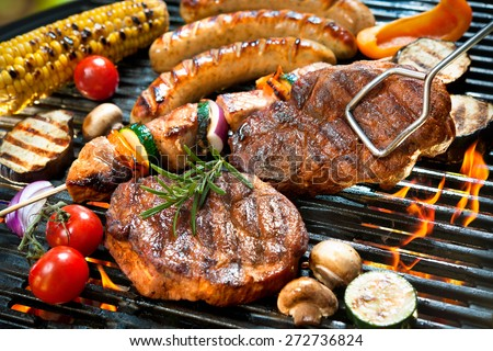 Assorted delicious grilled meat with vegetables over the coals on barbecue #272736824