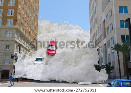 Tsunami tidal wave washing through a city street pushing cars out of the way and speeding towards a pedestrian