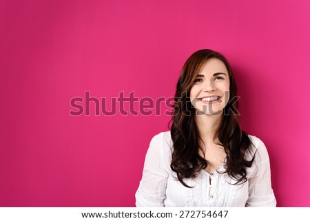 Close up Thoughtful Pretty Girl Looking Up with a Smile, Isolated on Pink Background with Copy Space. #272754647