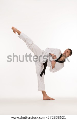 Fighter show foot kick on white background #272838521