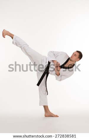 Fighter show foot kick on white background #272838581