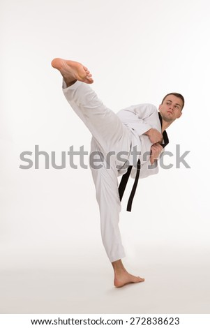 Fighter show foot kick on white background #272838623