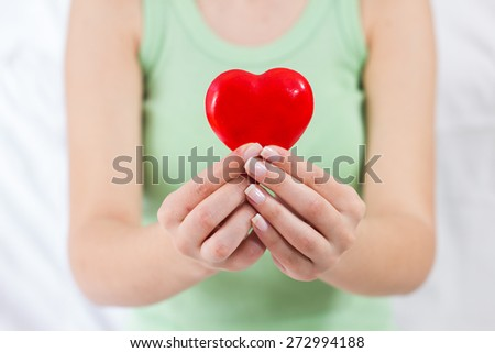 Health Care Love Support Red Heart in female hands. #272994188