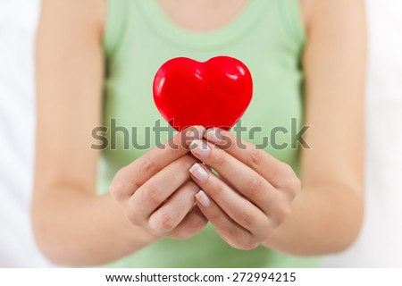 Health Care Love Support Red Heart in female hands. #272994215