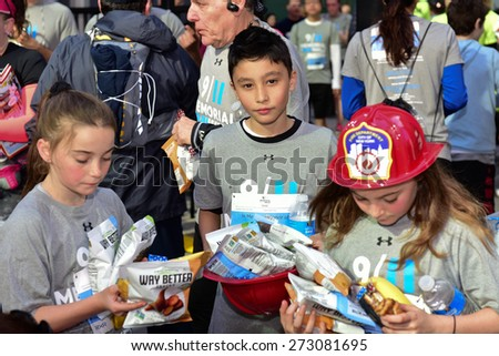 NEW YORK CITY - APRIL 26 2015: the 3rd annual Memorial 5K walk/run took place in Lower Manhattan to raise awareness of the National 911 Museum & Memorial followed by family day on Greenwich Street #273081695