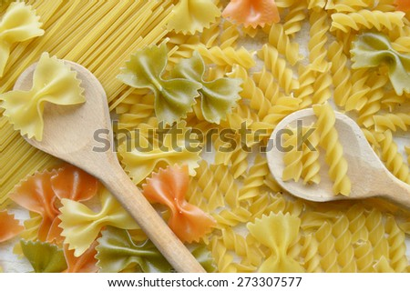 Different types of pasta, macro view on a wooden table #273307577