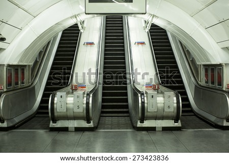 Viewpoint of the base of escalators at a public transportation station #273423836