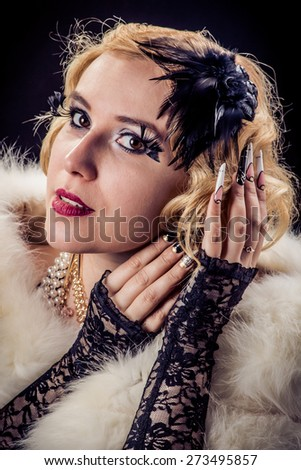Retro portrait of beautiful blonde woman with gold and pearl jewels and extreme long nails. Gatsby, Vintage style. Isolated on black background #273495857