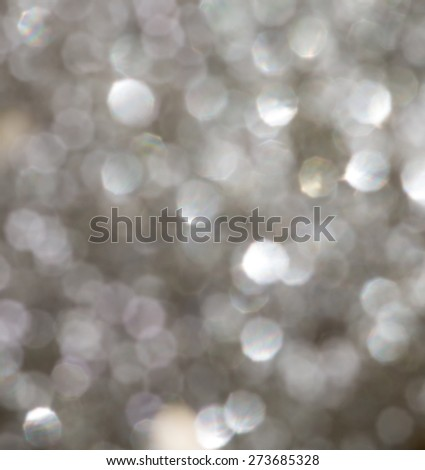 Defocused Bokeh twinkling lights Vintage background. Festive background with natural bokeh and bright golden lights. #273685328