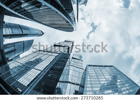 futuristic modern skyscrapers of glass and metal. Focus on buildings. toned photo #273710285