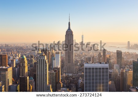 New York City. Manhattan downtown skyline with illuminated Empire State Building and skyscrapers at sunset. Royalty-Free Stock Photo #273724124