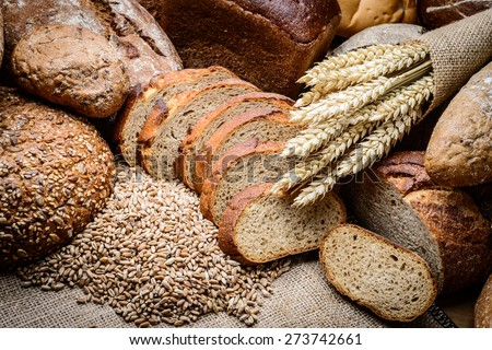 fresh bread  and wheat on the wooden Royalty-Free Stock Photo #273742661