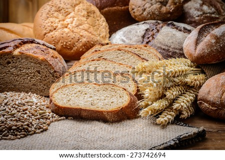 fresh bread  and wheat on the wooden #273742694