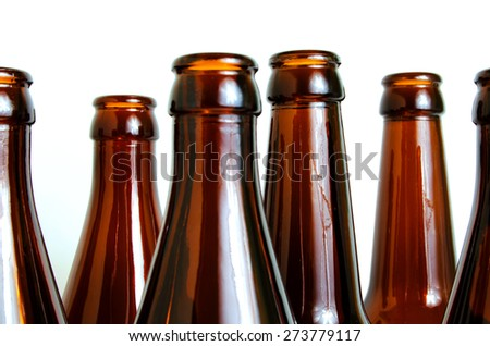 Empty glass bottles for industrial disposal. #273779117